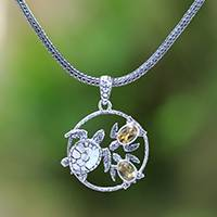 Citrine pendant necklace, 'Sea Turtle Family' - Citrine Sea Turtle Pendant Necklace from Bali