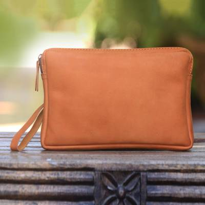Leather wristlet, 'Ginger Gula Jawa' - Handcrafted Leather Wristlet in Ginger from Java