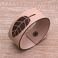 Leather wristband bracelet, 'One Leaf' - Leaf Motif Leather Wristband Bracelet from Java