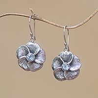 Blue topaz dangle earrings, 'Plumeria Sparkle' - Blue Topaz Frangipani Flower Dangle Earrings from Bali