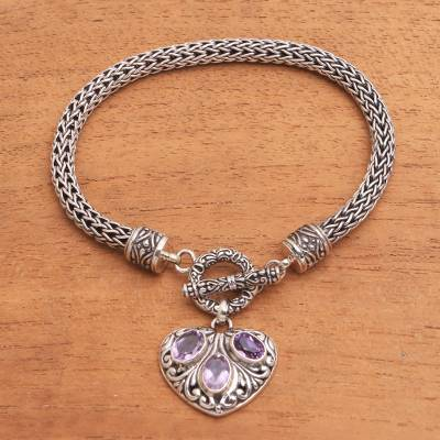 Amethyst charm bracelet, 'Three Times the Love' - Heart-Shaped Amethyst Charm Bracelet from Bali