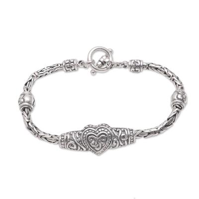 Sterling silver pendant bracelet, 'Heart Knot' - Heart-Shaped Sterling Silver Pendant Bracelet from Bali