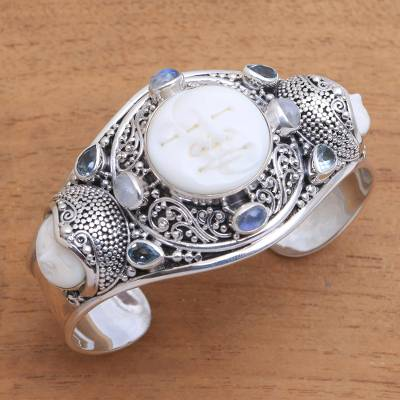 Rainbow moonstone and blue topaz cuff bracelet, 'Keeper of the Moon' - Rainbow Moonstone and Blue Topaz Cuff Bracelet from Bali