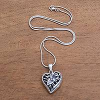 Sterling silver pendant necklace, 'Heart Flower' - Floral Heart-Shaped Sterling Silver Pendant Necklace