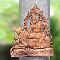 Wood relief panel, 'Shiva's Aura' - Hindu-Themed Suar Wood Relief Panel Crafted in Bali