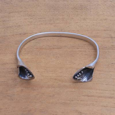 Sterling silver cuff bracelet, 'Floral Twins' - Sterling Silver Cuff Bracelet with Floral Ends from Bali