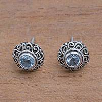 Blue topaz stud earrings, 'God Eye' - Swirl Pattern Blue Topaz Stud Earrings from Bali