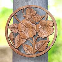 Wood relief panel, 'Butterfly on a Flower' - Floral Butterfly Suar Wood Relief Panel Crafted in Bali