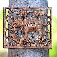 Wood relief panel, 'Elephant on Flowers' - Elephant-Themed Suar Wood Relief Panel Crafted in Bali