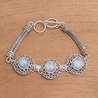 Rainbow moonstone and blue topaz pendant bracelet, 'Temple Roof'