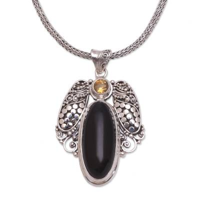 Onyx and citrine pendant necklace, 'Monolithic Oval' - Onyx and Citrine Pendant Necklace from Bali