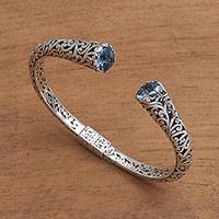 Blue topaz cuff bracelet, 'A Glimpse of Sky' - Blue Topaz and Sterling Silver Scroll Motif Cuff Bracelet