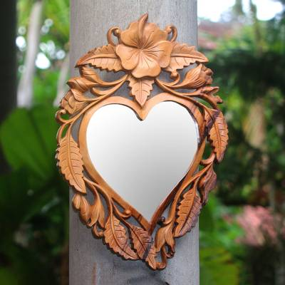 Wood wall mirror, 'Jepun Heart' - Heart-Shaped Frangipani Flower Wood Wall Mirror from Bali