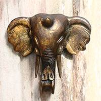 Wood wall sculpture, 'Glorious Elephant' - Antiqued Gold-Tone Wood Elephant Wall Sculpture from Bali