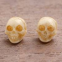 Bone stud earrings, 'Faces of Trunyan' - Hand-Carved Skull Bone Stud Earrings from Bali
