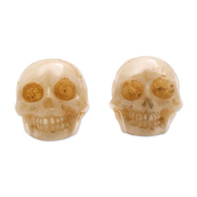Bone stud earrings, 'Faces of Trunyan' - Hand-Carved Skull Bone Stud Earrings from Bali