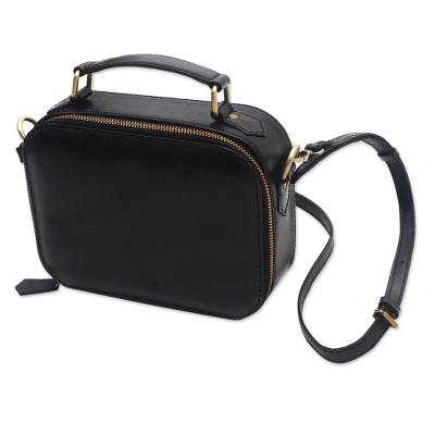 Black Leather Handbag with a Strap and Handle