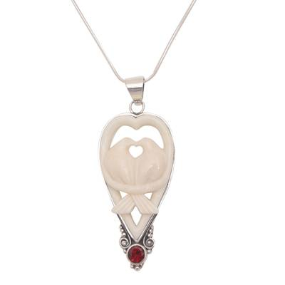 Garnet and bone pendant necklace, 'Dove Couple' - Garnet and Bone Dove Pendant Necklace from Bali