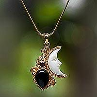 Gold plated onyx and garnet pendant necklace, 'Crescent Mystery' - Gold Plated Onyx and Garnet Pendant Necklace from Bali