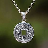 Sterling silver pendant necklace, 'Bali Aksara' - Traditional Coin Sterling Silver Pendant Necklace from Bali