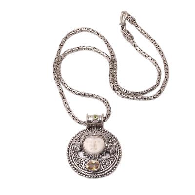Citrine and peridot pendant necklace, 'Sukawati Guardian' - Citrine and Bone Pendant Necklace Crafted in Bali