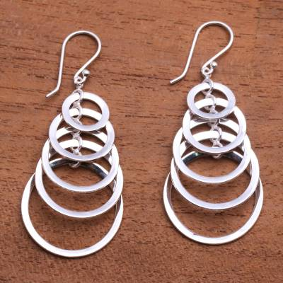 Sterling silver dangle earrings, 'Shimmering Moons' - 925 Sterling Silver Dangle Earrings with Circle Pattern