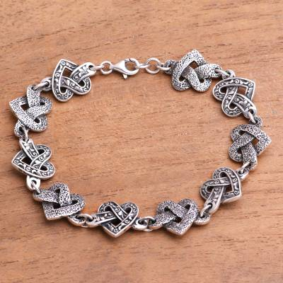 Sterling silver link bracelet, 'Combined Love' - Heart-Shaped Sterling Silver Link Bracelet from Java