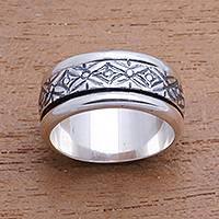 Sterling silver spinner ring, 'Kawung Jawa' - Kawung and Jawa Motif Sterling Silver Spinner Ring from Java