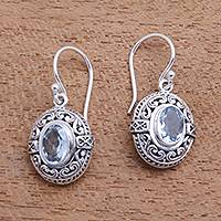 Blue topaz dangle earrings, 'Central Glitter' - 3-Carat Oval Blue Topaz Dangle Earrings from Bali
