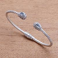 Blue topaz cuff bracelet, 'Generous Sparkle' - Faceted Blue Topaz Cuff Bracelet from Bali