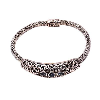 Blue topaz pendant bracelet, 'Warrior Queen' - Faceted Blue Topaz Pendant Bracelet from Bali