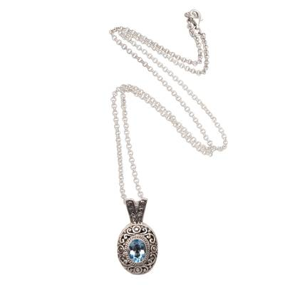 Blue topaz pendant necklace, 'Angel Eye' - Swirl Pattern Blue Topaz Pendant Necklace from Bali