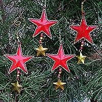 Steel ornaments, 'Passionate Stars' (set of 4) - Handmade Steel Star Ornaments from Bali (Set of 4)