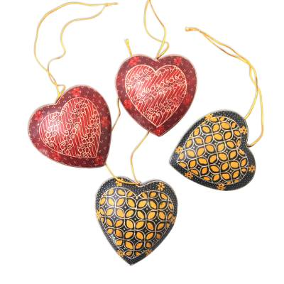 Batik wood ornaments, 'Traditional Hearts' (set of 4) - Traditional Batik Wood Heart Ornaments from Java (Set of 4)