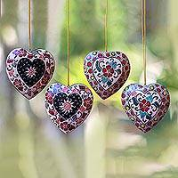 Batik wood ornaments, 'Heart Flowers' (set of 4) - Floral Batik Wood Heart Ornaments from Java (Set of 4)