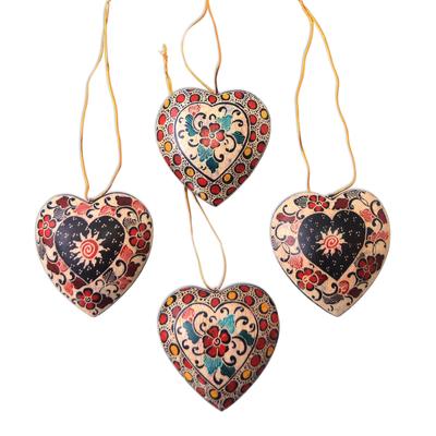 Batik wood ornaments, 'Heart Flowers' (set of 4) - Floral Batik Wood Heart Ornaments from Java (Set of 4)