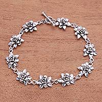 Sterling silver link bracelet, 'Lotus Constellation' - Lotus Flower Sterling Silver Link Bracelet from Bali