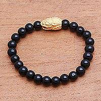 Gold accented onyx beaded stretch bracelet, 'Fierce Snake' - Gold Accented Snake-Themed Onyx Beaded Stretch Bracelet