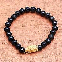 Gold accented onyx beaded stretch bracelet, 'Alert Eagle' - Gold Accented Eagle-Themed Onyx Beaded Stretch Bracelet