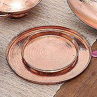 Copper trays, 'Gleaming Circles' (pair) - Handcrafted Circular Copper Trays from Bali (Pair)