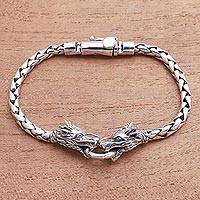 Men's sterling silver pendant bracelet, 'Dueling Dragons' - Men's Sterling Silver Dragon Pendant Bracelet from Bali