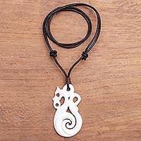 Bone and garnet pendant necklace, 'Nautical Glory' - Swirl Pattern Bone and Garnet Pendant Necklace from Bali