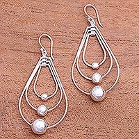 Sterling silver dangle earrings, 'Droplet Orbits' - Drop-Shaped Sterling Silver Dangle Earrings from Bali