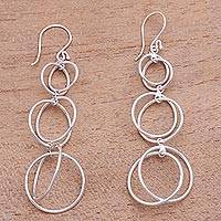 Sterling silver dangle earrings, 'Interlocking Orbits' - Circular Sterling Silver Dangle Earrings from Bali