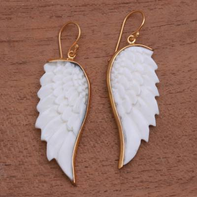 Gold accented bone dangle earrings, 'Wings of Change' - Gold Accented Bone Wing Dangle Earrings from Indondesia