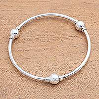 Sterling silver bangle bracelet, 'Round Trio' - Orb Motif Sterling Silver Bangle Bracelet from Bali