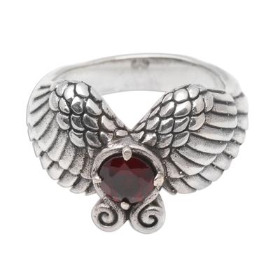 Garnet band ring, 'Winged Glitter' - Wing Motif Garnet Band Ring from Bali