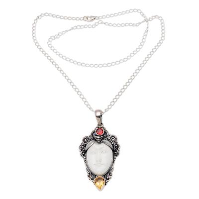 Garnet pendant necklace, 'Glittering Wing' - Wing-Shaped Garnet Pendant Necklace from Bali