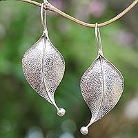 Sterling silver drop earrings, 'Curved Leaves' - Modern Leaf-Shaped Sterling Silver Drop Earrings from Bali