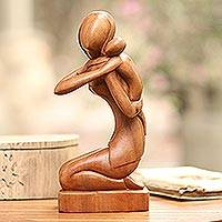 Wood sculpture, 'Carrying Her Child'